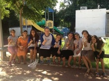 Dina (Molotsky) Feuchtwanger, class of '02, pictured (center) with children and counselors from a summer program that she runs.